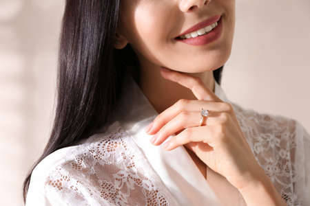Young woman wearing beautiful engagement ring, closeup 免版税图像