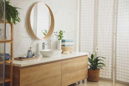 Stylish bathroom interior with mirror and countertop. Design idea