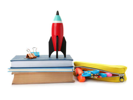 Bright toy rocket and school supplies on white background Stock Photo