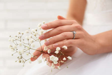 Young bride wearing beautiful engagement ring, closeup
