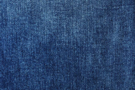 Texture of dark blue jeans as background, closeup Фото со стока