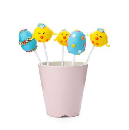 Different delicious sweet cake pops on white background. Easter holiday
