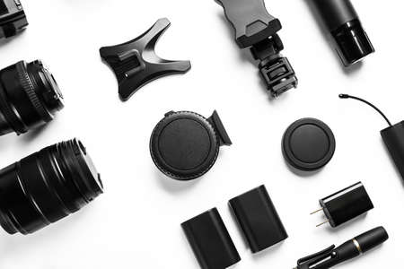 Composition with video production equipment for camera on white background, top view