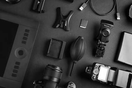 Flat lay composition with video production equipment for camera on black background