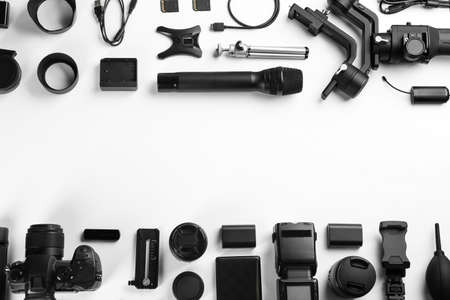 Composition with camera and video production equipment on white background, top view with space for text