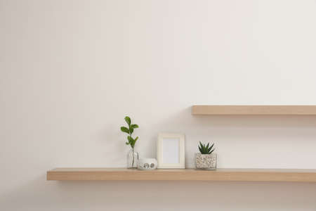 Wooden shelves with plants and photo frame on light wall Фото со стока - 140969447
