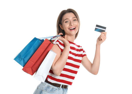 Young woman with credit card and shopping bags on white background. Spending money