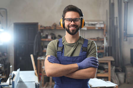 Portrait of professional male carpenter in workshop