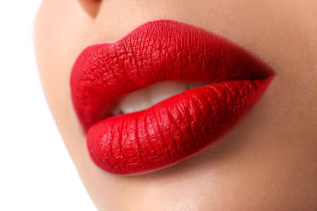 Woman with red lipstick on white background, closeup