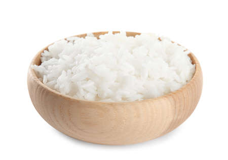 Wooden bowl with cooked rice isolated on white