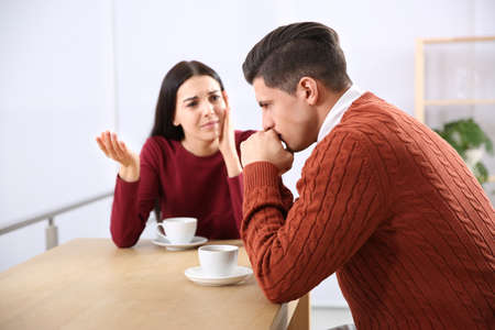 Couple having quarrel in cafe. Relationship problems