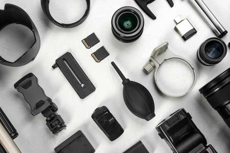Flat lay composition with camera lens and video production equipment on light table Banco de Imagens