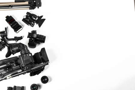 Flat lay composition with video camera and other equipment on white background. Space for text