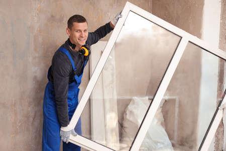 Worker in uniform with plastic window indoors
