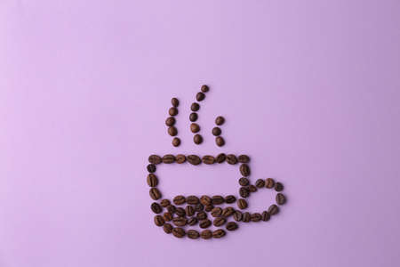 Cup made of coffee beans on lilac background, flat lay