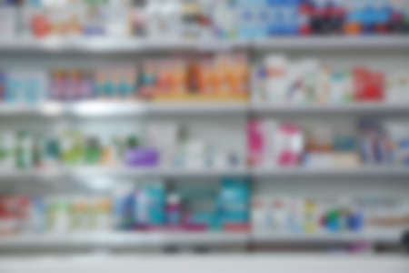 Blurred view of modern pharmacy interior with different medicine
