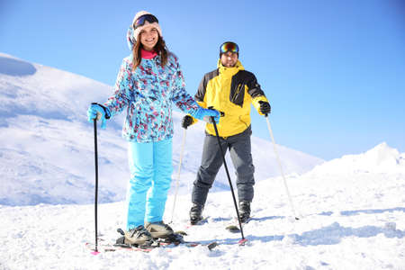 Young couple skiing on hill. Winter vacation Standard-Bild