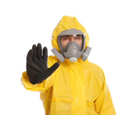 Man in chemical protective suit making stop gesture on white background. Virus research