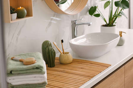 Stylish vessel sink on light countertop in modern bathroom Archivio Fotografico