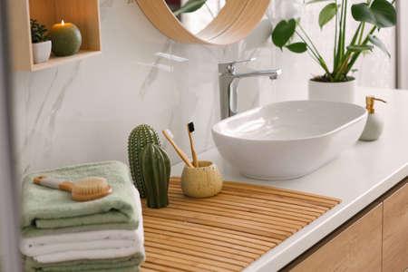 Stylish vessel sink on light countertop in modern bathroom Stock Photo