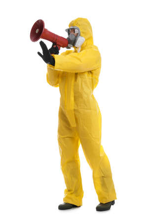 Man wearing chemical protective suit with megaphone on white background. Prevention of virus spread