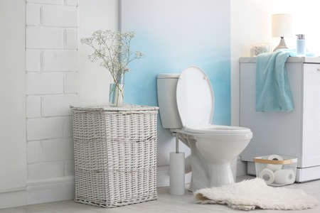 Modern toilet bowl in stylish bathroom interior