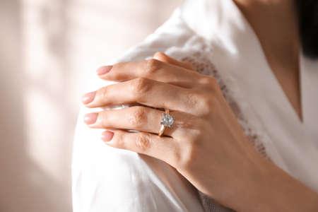 Young woman wearing beautiful engagement ring, closeup Standard-Bild