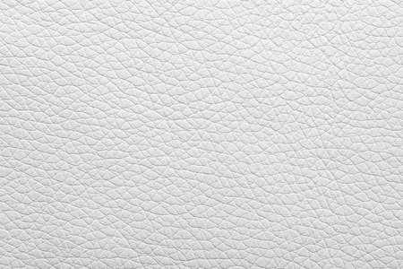 Texture of light leather as background, closeup Standard-Bild