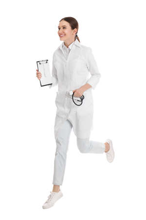 Doctor with clipboard running on white background