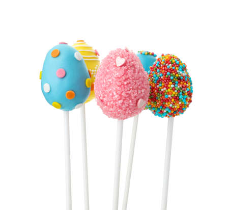 Delicious egg shaped cake pops on white background. Easter holiday