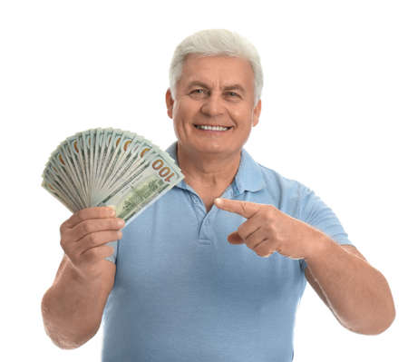 Happy senior man with cash money on white background