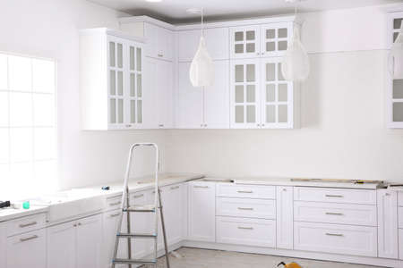 Renovated kitchen interior with stylish furniture and maintenance equipment