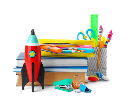 Bright toy rocket and school supplies on white background Stockfoto