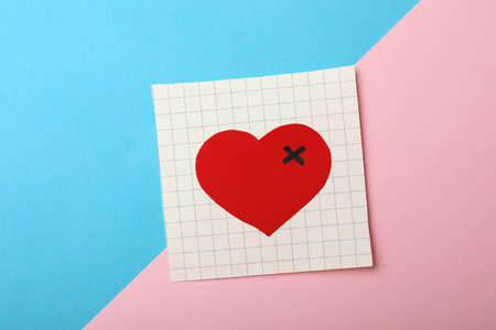 Paper with drawn heart on color background, top view. Relationship problems concept