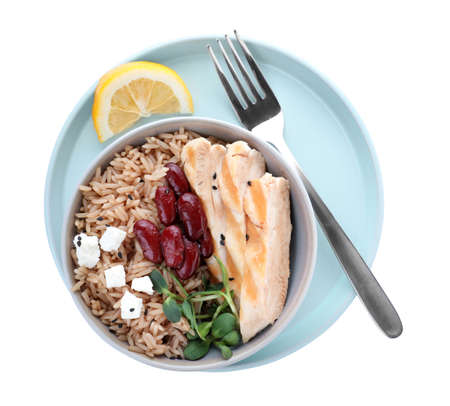 Tasty brown rice with beans and chicken meat isolated on white, top view