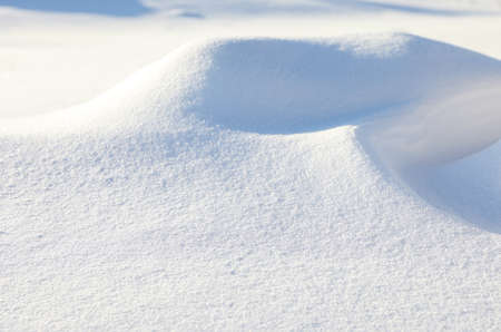 Beautiful snowdrift as background, closeup view. Winter weather