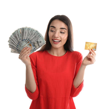 Young woman with money and credit card on white background Stockfoto