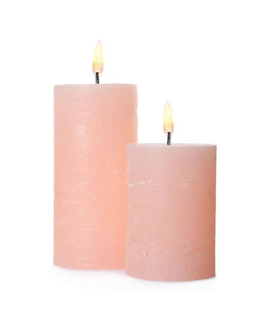 Pink candles with wicks isolated on white 免版税图像