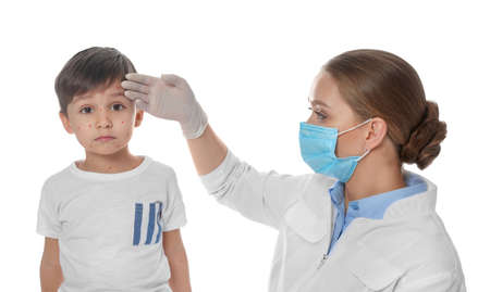 Doctor examining little boy with chickenpox on white background. Varicella zoster virus