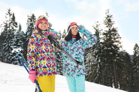 Young skiers wearing winter sport clothes outdoors