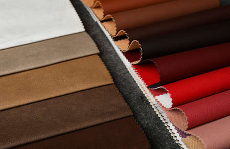 Leather samples on grey stone background, closeup