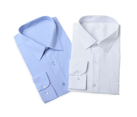 Stylish shirts isolated on white, top view. Dry-cleaning service Foto de archivo