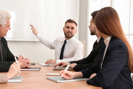 Professional business trainer working with people in office