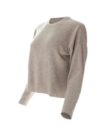 Stylish sweater on mannequin against white background. Women's clothes Foto de archivo
