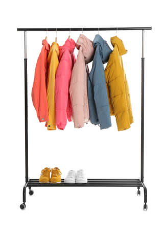 Rack with stylish jackets and shoes isolated on white