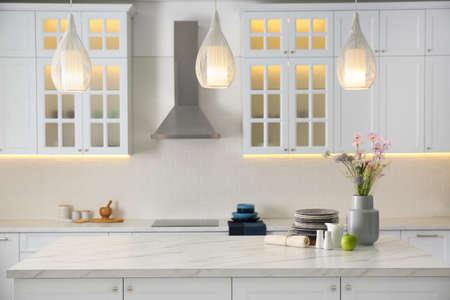 Modern kitchen interior with stylish white furniture
