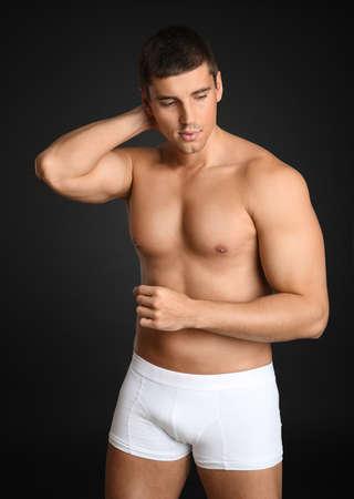 Man with sexy body on grey background