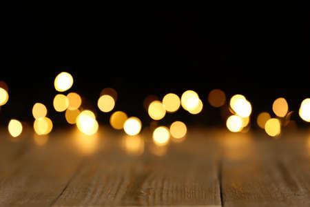 Wooden table and festive lights. Bokeh effect Reklamní fotografie