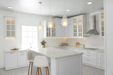 Beautiful kitchen interior with new stylish furniture Фото со стока