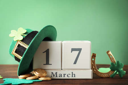 Composition with block calendar on wooden table. St. Patrick's Day celebration
